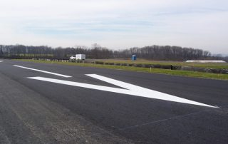 fresh painted arrow on roadway