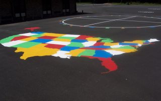 map of USA on asphalt