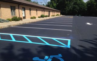 fresh line striping by commercial building
