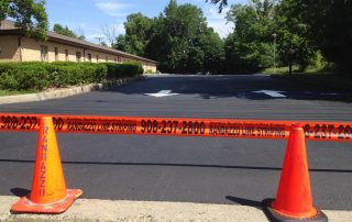 Randazzo Line Striping tape in front of parking area