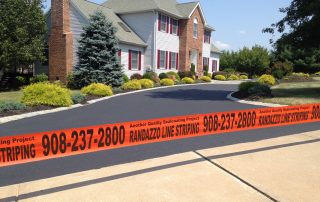 Randazzo Line Striping tape by driveway