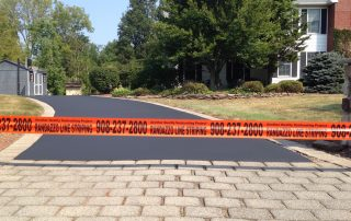 Randazzo Line Striping tape in front of driveway
