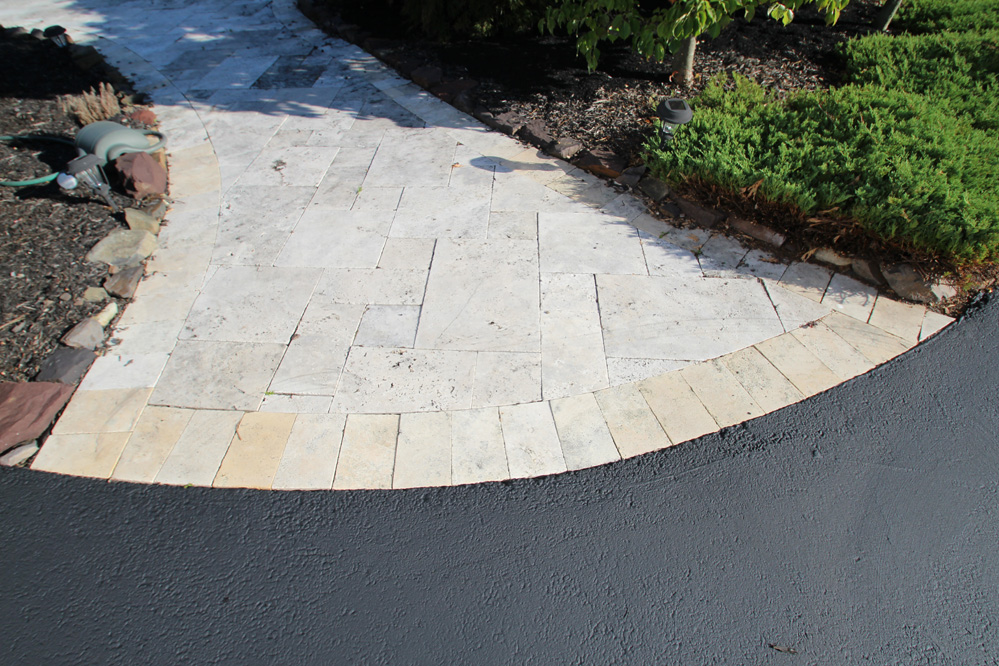 paver walk with sealcoated driveway